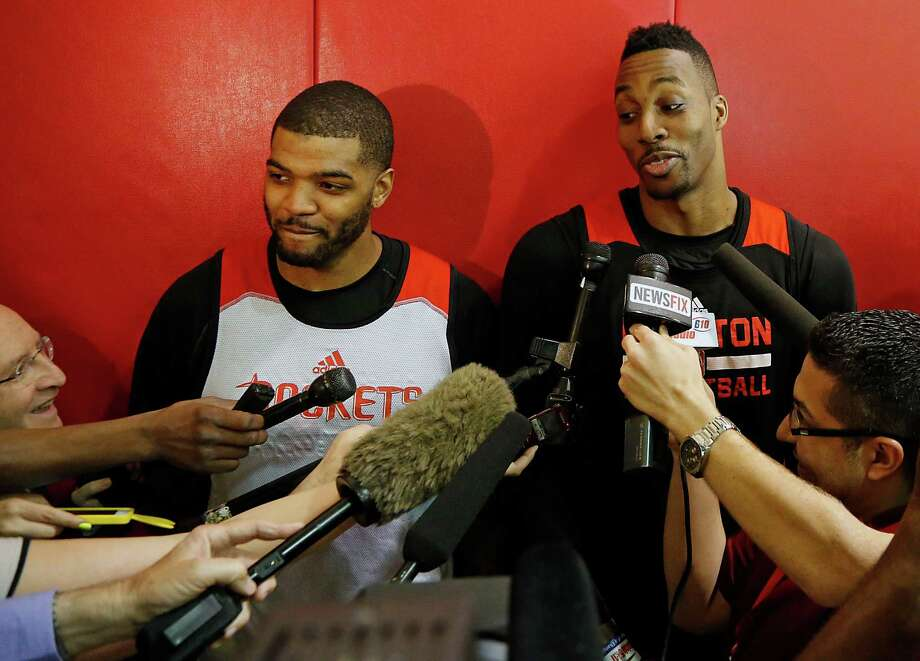 Rockets forward Josh Smith, left, and center Dwight Howard, right, enjoy a rare camaraderie that dates to their days as teammates on the Atlanta Celtics, a celebrated AAU team. Photo: James Nielsen, Staff / © 2015  Houston Chronicle