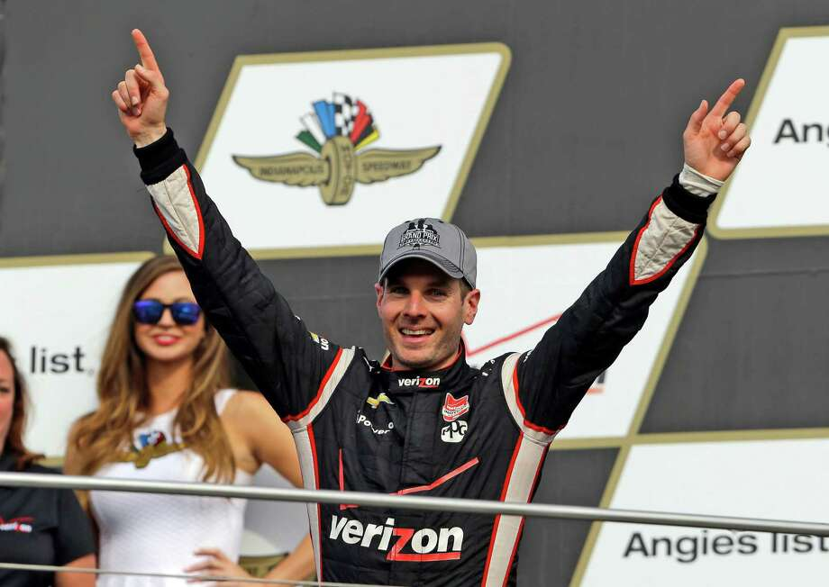 Will Power celebrates his first IndyCar victory of the season after winning the Grand Prix of Indianapolis. Photo: Michael Conroy, STF / AP