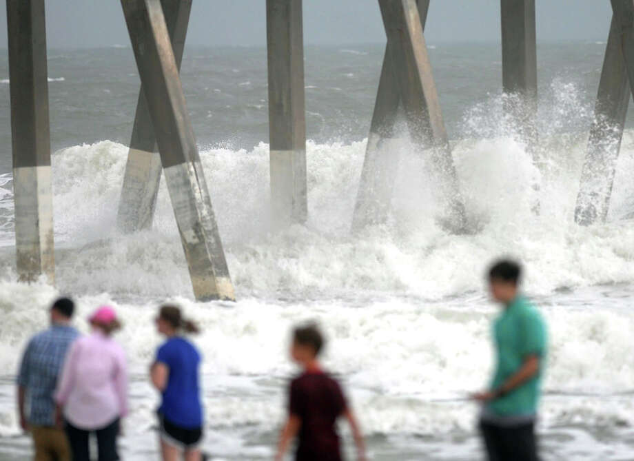 People gather on the beach to watch the big surf from Tropical Storm Ana in Wrightsville Beach, N.C. Saturday, May 9, 2015. Beachgoers were warned away, emergency officials kept a watchful eye and at least one graduation ceremony was forced indoors as Tropical Storm Ana plodded toward the Carolinas on Saturday in an early heaping of rough weather weeks ahead of the official start of the Atlantic hurricane season.  (Matt Born/The Star-News via AP) Photo: Matt Born, MBO / The Star-News