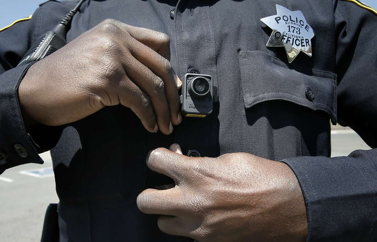 Officer Terry Thomas displays the video camera Richmond Police officers have been wearing since the first of this year, seen while on patrols in Richmond, Calif., on Sat. May 9, 2015.