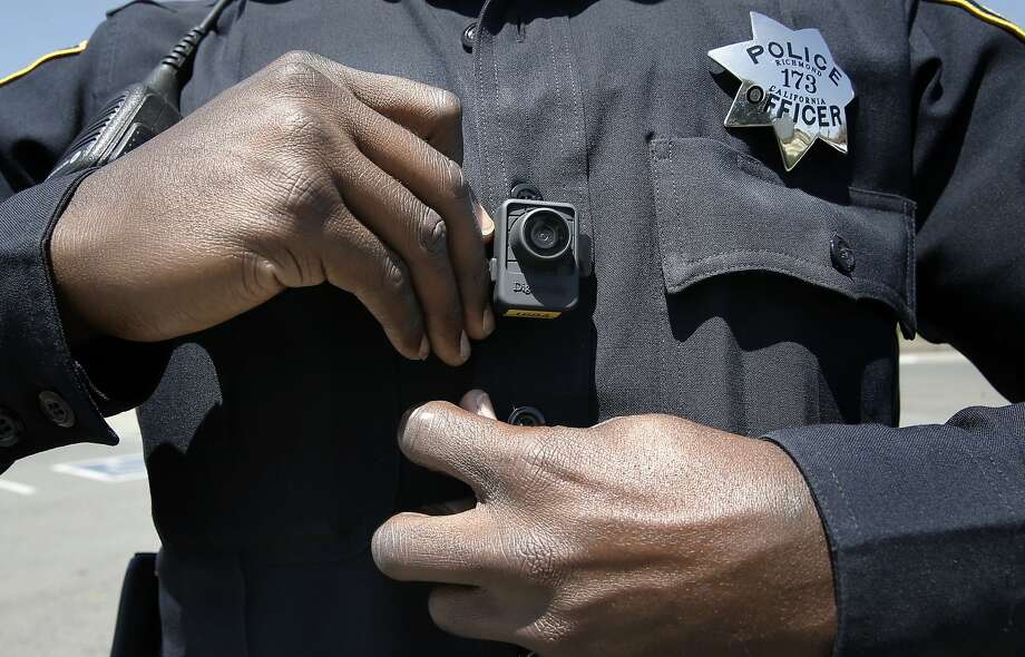 Officer Terry Thomas displays the video camera  Richmond Police officers have been wearing since the first of this year, seen while on patrols in Richmond, Calif., on Sat. May 9, 2015. Photo: Michael Macor, The Chronicle