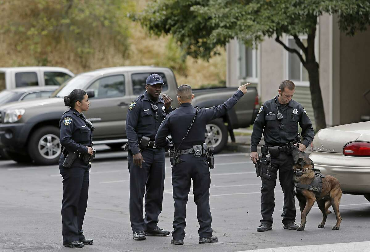 Richmond Police officers team up for a call near Hilltop Mall, in Richmond, Calif. on Sat. May 9, 2015. Richmond Police officers have been wearing the small cameras since the first of this year.