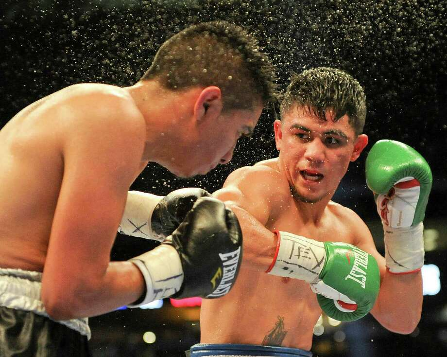 Joseph Diaz Jr., right, punches Giovani Delgado during the tenth round of their featherweight match, Saturday, May 9, 2015, at Minute Maid Park in Houston. (Photo: Eric Christian Smith/For the Chronicle) Photo: Eric Christian Smith, For The Chronicle / 2015 Eric Christian Smith