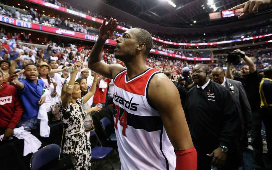 Forward Paul Pierce celebrates with fans after his buzzer-beater Saturday gave the Wizards a 2-1 series lead. Photo: Rob Carr, Staff / 2015 Getty Images