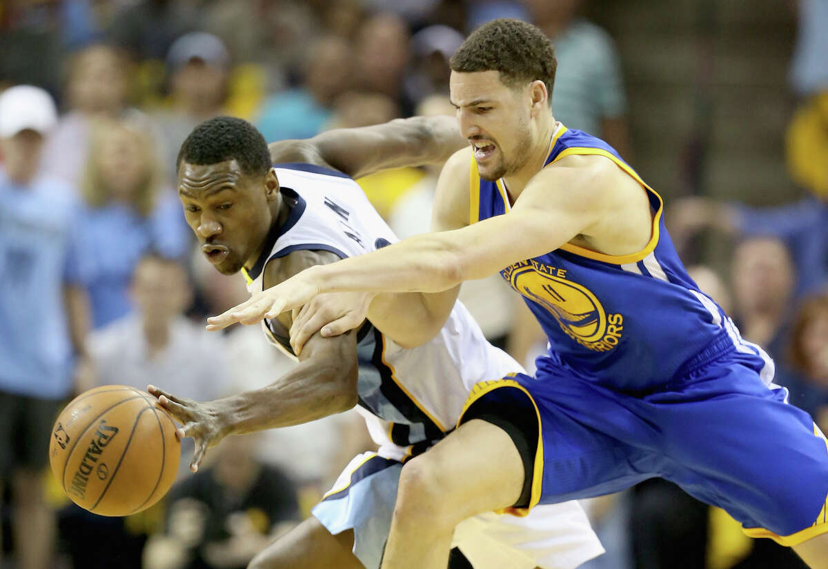 Memphis' Tony Allen swipes the ball from Klay Thompson. Allen had four steals, giving him 11 in three games in the series.
