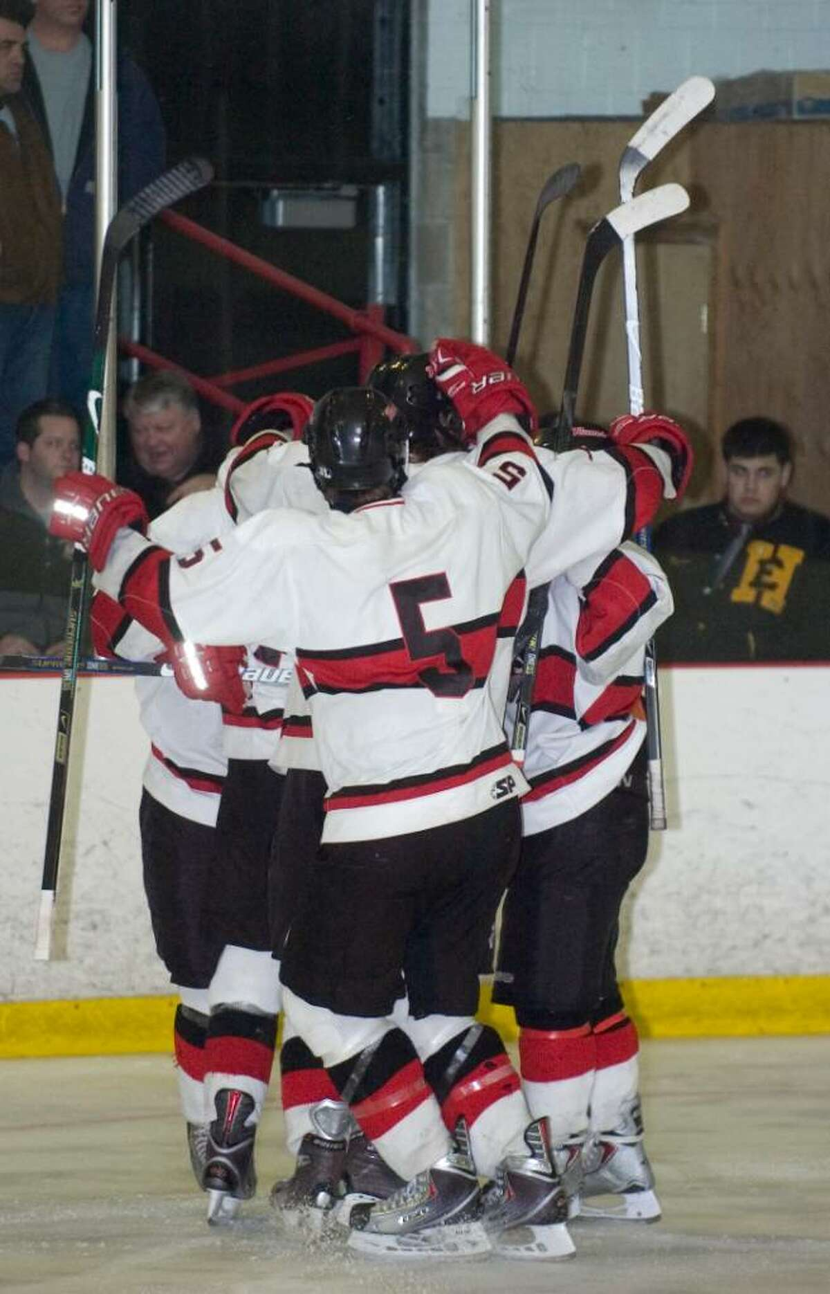 New Canaan celebrates after scoring a goal during the first round of the CIAC Division I ice hockey tournament at the Darien Ice Rink in Darien, Conn. on Wednesday, March 10, 2010.