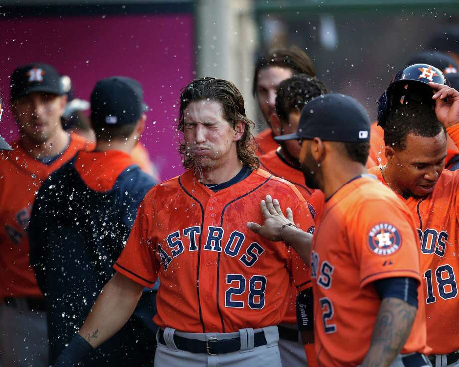 Left fielder Colby Rasmus (28) hit one of the Astros' three home runs Saturday to help break the offense out of a weeklong slump and lift the team past the Angels 6-5. Photo: Karen Warren, Staff / © 2015 Houston Chronicle