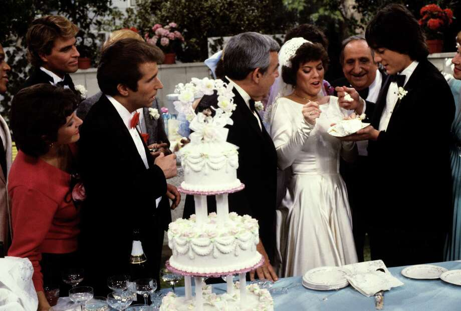 "UNITED STATES - MAY 08:  HAPPY DAYS - ""Passages - Part II"" - ""The Wedding"" - 5/8/84, Lori Beth (Lynda Goodfriend), Roger (Ted McGinley), Fonzie (Henry Winkler), Howard (Tom Bosley), Al (Al Molinaro) and Marion (Marion Ross) attended Joanie (Erin Moran) and Chachi's (Scott Baio) wedding., Photo: ABC, Getty Images / ©1984, American Broadcasting Companies, Inc. All rights reserved. For editorial use only. NO ARCHIVING. NO RESALE."
