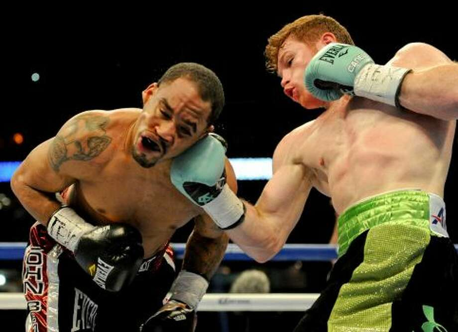 Canelo Alvarez, punches James Kirkland during the first round of their super welterweight match, Saturday, May 9, 2015, at Minute Maid Park in Houston. Alvarez won the fight with a knockout in the third round. Photo: Photo By Eric Christian Smith/Eric Christian Smith/For The Chronicle