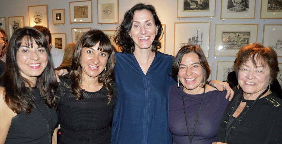 """Pulitzer Prize-winning photojournalist Lynsey Addario, second from left, with sisters Lesley, Lisa and Lauren, and their mother Camille at the Westport Library's """"Booked for the Evening"""" program honoring Lynsey on Saturday night. Photo: Jarret Liotta / Westport News"""