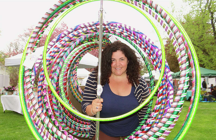 Nicole Mikula of Bring the Hoopla at the Fairfield Woman's Club Market on the Green Arts & Crafts Fair on Town Hall Green. Photo: Mike Lauterborn / Fairfield Citizen