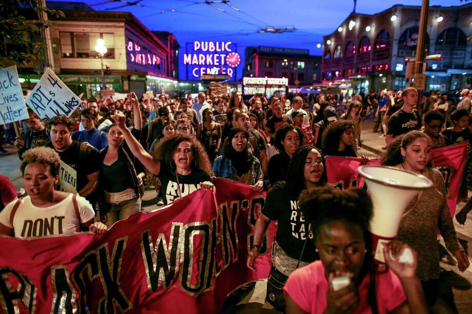 Marchers make their way past the Pike Place Market during an anti-police brutality march in downtown Seattle. Protesters marched in solidarity with protesters in Baltimore and Ferguson that have loudly voiced concerns over the deaths of black men at the hands of police officers. Photographed on Saturday, May 9, 2015. Photo: JOSHUA TRUJILLO, SEATTLEPI.COM / SEATTLEPI.COM