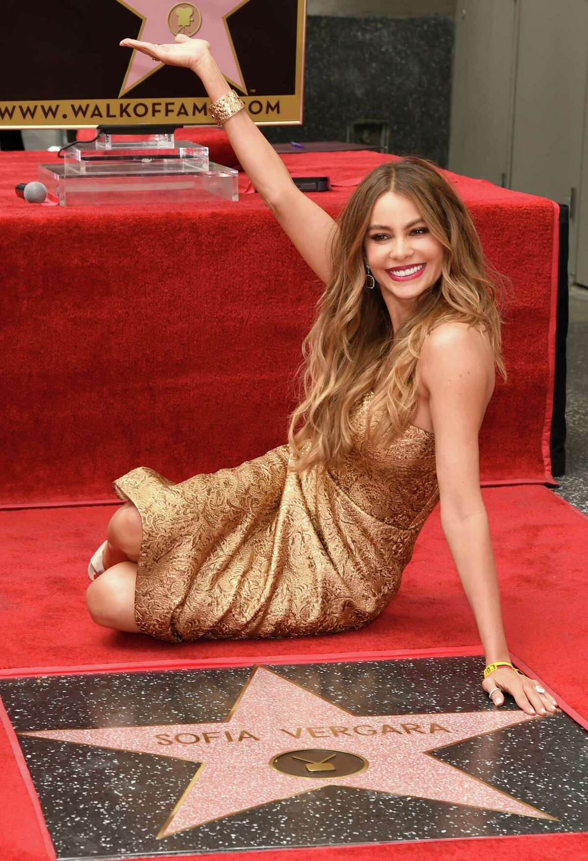 Sofia Vergara gestures at a ceremony where she is awarded a star on the Hollywood Walk of Fame on Thursday, May 7, 2015, in Los Angeles.