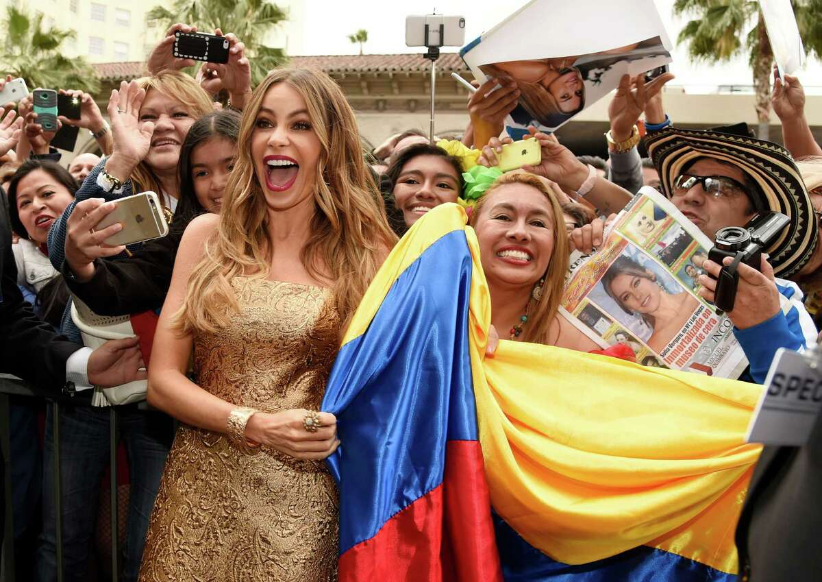 Colombian actress Sofia Vergara poses with fans holding a Colombian flag after she received a star on the Hollywood Walk of Fame on Thursday, May 7, 2015, in Los Angeles.