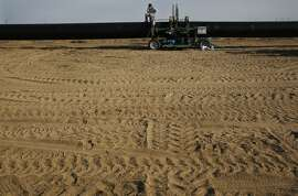 Humberto Ortiz sits on top of two massive pipes as they are connected by a machine while he and a crew work to lay six miles of pipeline that will be used to transport water to a local large farm April 10, 2015 near Kings County, Calif. The land is situated in part of the San Joaquin Valley that used to contain the Tulare Lake, the largest freshwater lake in the western half of the continental United States. The lake was dried up by the year 1900 due to emerging agriculture in the region.