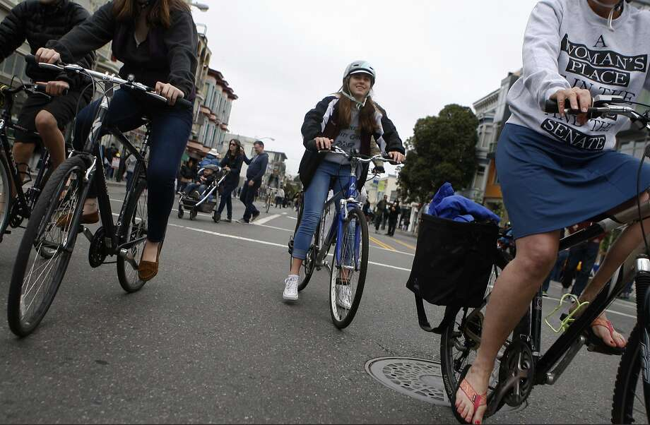 People ride their bikes down Valencia Street during the Mission Sunday Streets festival Sunday, May 10, 2015. Photo: Jessica Christian, The Chronicle