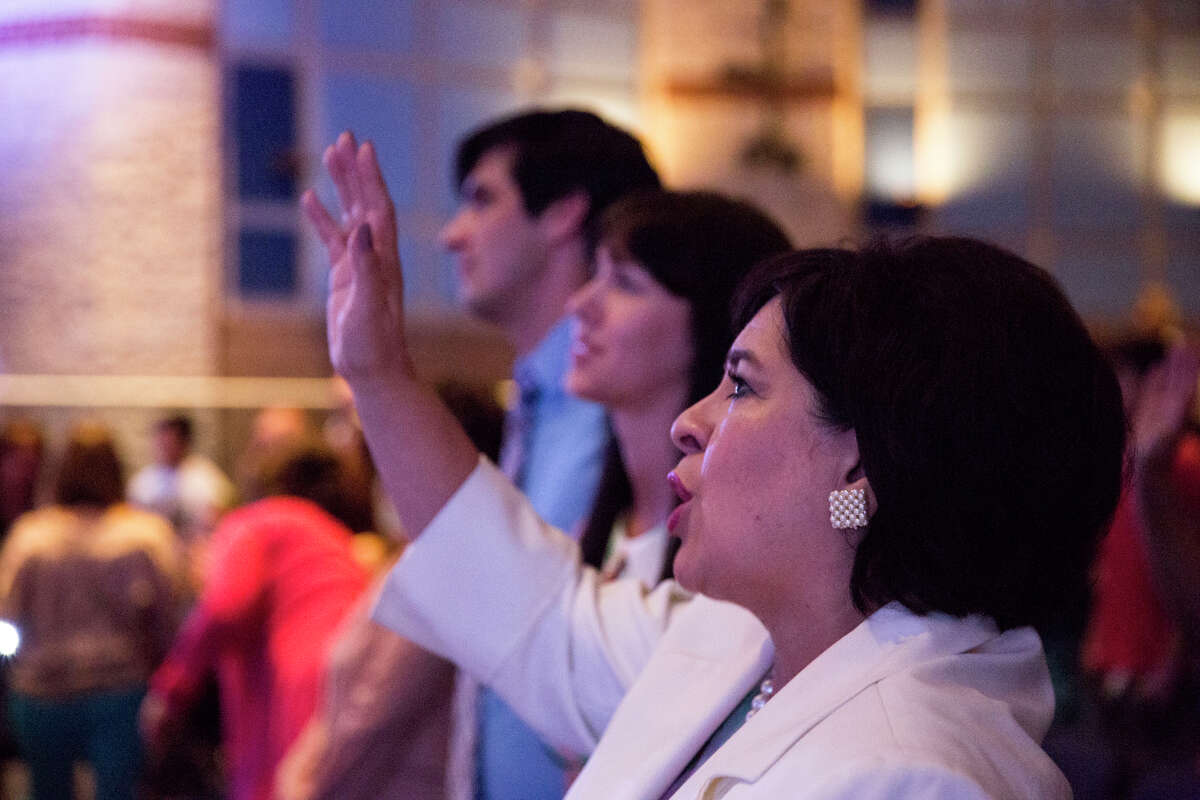 Mayoral candidate Leticia Van de Putte sings with her family during a service with 210 Church at Johnson High School in San Antonio, Texas on Sunday, May 10, 2015.