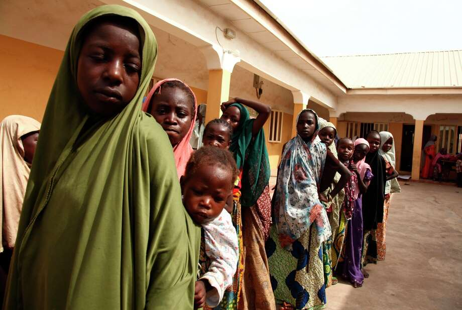 Girls rescued by Nigerian soldiers after being abducted by members of Boko Haram line up to collect donated clothes at the Malkohi refugee camp in Yola last week. Photo: EMMANUEL AREWA / AFP / Getty Images / AFP