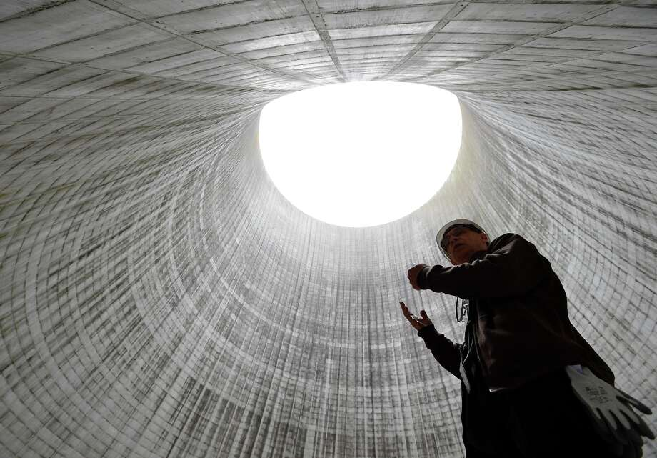 Tom Wallace, the senior manager for Unit 2, leads a tour inside the cooling tower at the Watts Bar Nuclear Plant near Spring City, Tenn., which has been under construction since 1979. Photo: Mark Zaleski / Associated Press / FR170793 AP