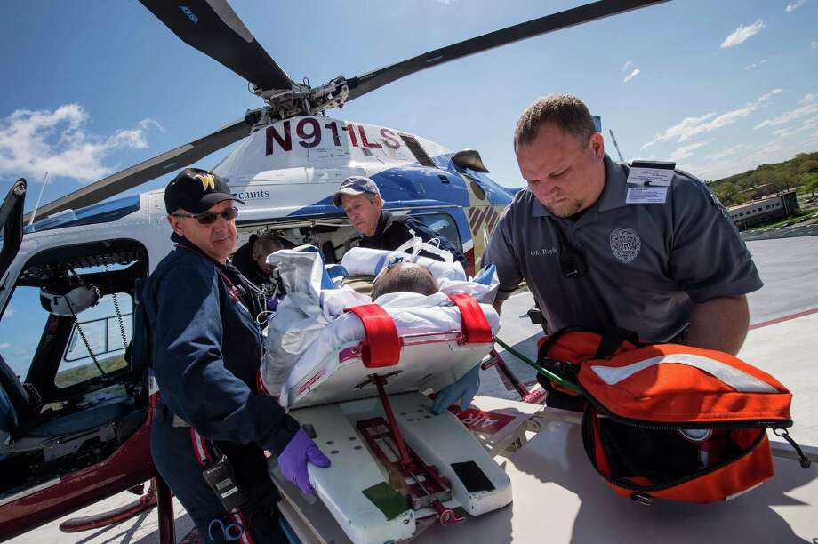 An air ambulance crew from Life Star of Kansas delivers a patient to Stormont-Vail Hospital in Topeka, Kan. A nonprofit, Life Star's fees are lower than those charged by many in an aggressively expanding air ambulance sector. Now, leaner reimbursements from insurers could leave patients even more financially vulnerable. Photo: Craig Hacker /New York Times / NYTNS