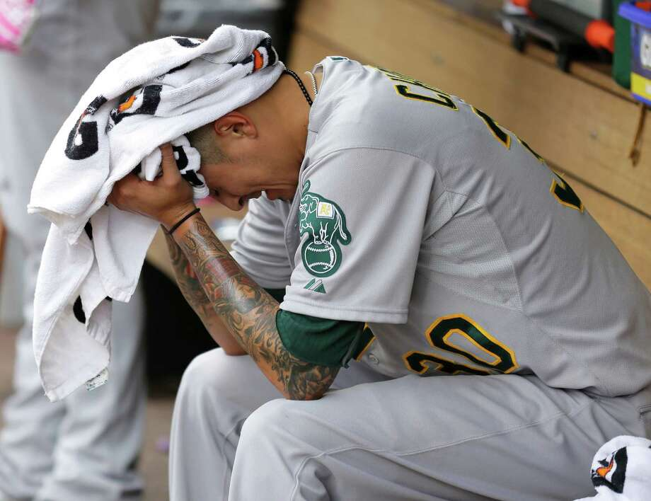 A's starting pitcher Jesse Chavez Jesse Chavez buries his head in a towel after being pulled from the game in the seventh. Photo: Ted S. Warren / Associated Press / AP