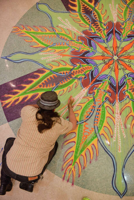 Artist Joe Mangrum creates a sand painting on the floor of the University Presbyterian Church's Center for Education Sunday. Photo: Robin Jerstad, San Antonio Express-News