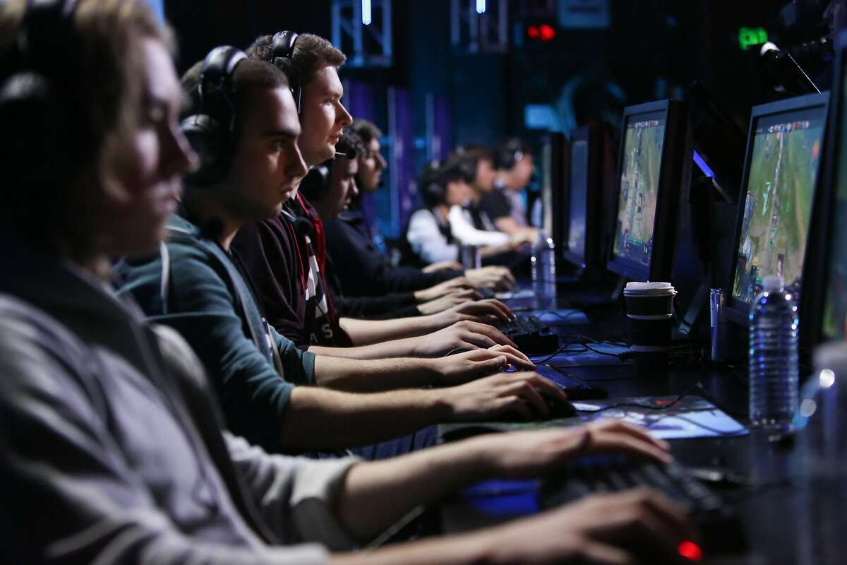 Teams Secret (left) and Invictus compete against one another in the Dota 2 (Defense of the Ancients) video game tournament to begin at the Warfield Theater in San Francisco, Calif., on Sunday, May 10, 2015.