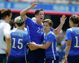 Teammates congratulate Abby Wambach (center) after her second goal in the U.S. women's 3-0 defeat of Ireland.