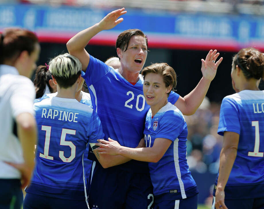 Teammates congratulate Abby Wambach (center) after her second goal in the U.S. women's 3-0 defeat of Ireland. Photo: Brian Bahr / Getty Images / 2015 Getty Images