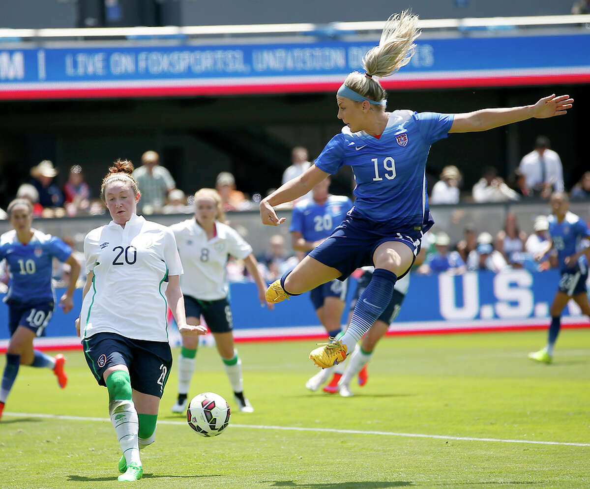 Santa Clara alum Julie Johnston (No. 19) shoots in the first half. Johnson would later score the third and final U.S. goal.