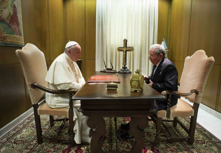 Pope Francis meets with Cuban President Raul Castro, right, during a private audience at the Vatican, Sunday, May 10, 2015. Cuban President Raul Castro has been welcomed at the Vatican by Pope Francis, who played a key role in the breakthrough between Washington and Havana aimed at restoring U.S.-Cuban diplomatic ties. (L'Osservatore Romano/Pool Photo via AP) Photo: L'Osservatore Romano, POOL / L'Osservatore Romano Pool