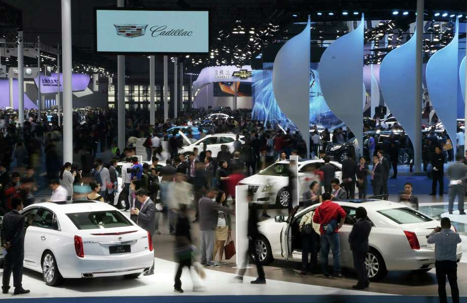 Visitors look at GM'S Cadillac at the Auto Shanghai 2015 in Shanghai. Half of the vehicles that GM sells in China are Wulings, inexpensive, low-margin minivans designed by one of General Motors' Chinese partners, targeted mostly at commercial buyers. In 2014, Chinese customers bought 1.6 million Wulings and only 79,000 high-profit Cadillacs. Photo: Tomohiro Ohsum /Bloomberg News