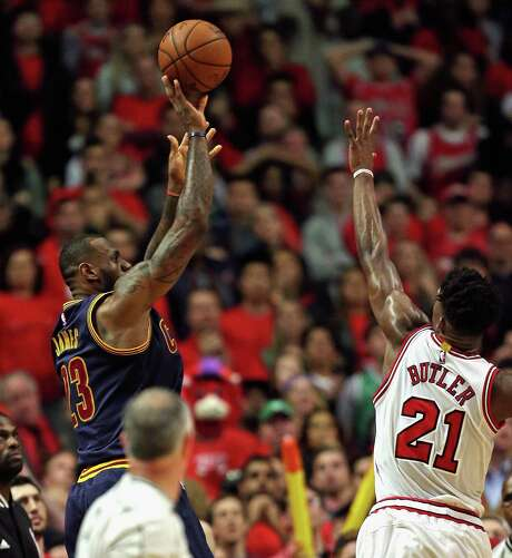 LeBron James, left, gets enough separation from the Bulls' Jimmy Butler to knock down a jumper at the buzzer that helped the Cavaliers even the series. Photo: Jonathan Daniel, Staff / 2015 Getty Images