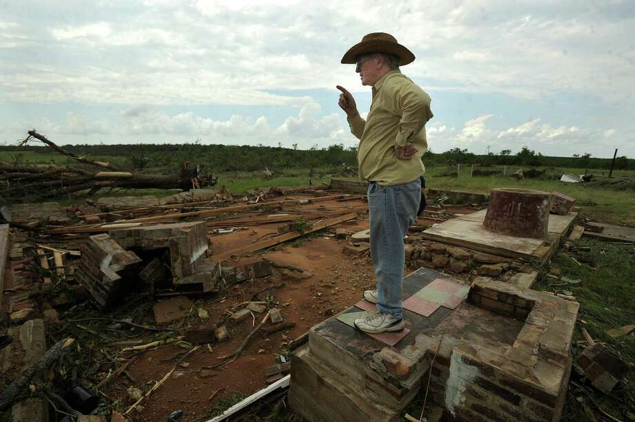 Ronnie Hastings looks over what used to be his grandfather's home on Sunday, after a deadly storm south of Cisco.  Photo: Tommy Metthe, MBR / The Abilene Reporter-News