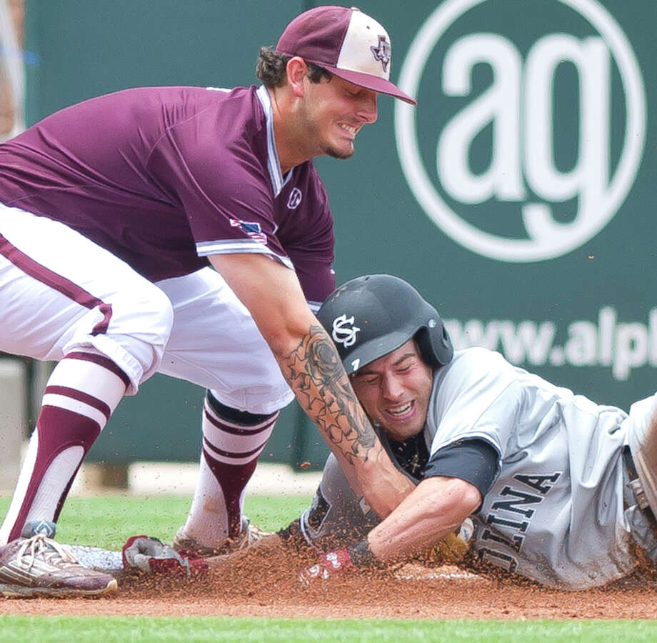 A&M third baseman Logan Nottebrok puts the tag on South Carolina's D.C. Arendas, who was trying to stretch a double into a triple. Photo: Dave McDermand/The Eagle