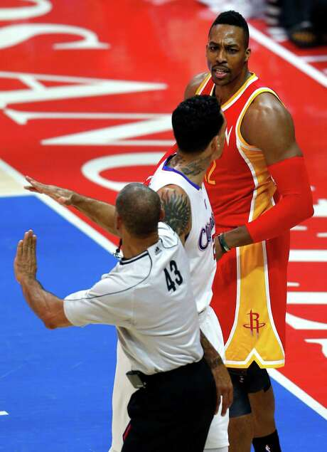 An altercation with the Clippers' Matt Barnes, center, earns Dwight Howard a technical foul during Sunday's first half. Photo: Karen Warren, Staff / © 2015 Houston Chronicle