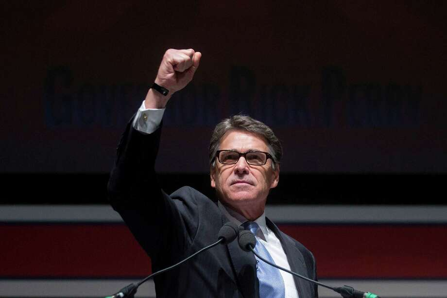 Rick Perry, former governor of Texas, gestures while speaking during the South Carolina Freedom Summit hosted by Citizens United and Congressman Jeff Duncan in Greenville, South Carolina, U.S., on Saturday, May 9, 2015. The Freedom Summit brings grassroots activists from across South Carolina and the surrounding area to hear from conservative leaders and presidential hopefuls. Photographer: Andrew Harrer/Bloomberg  Photo: Andrew Harrer / Bloomberg / © 2015 Bloomberg Finance LP