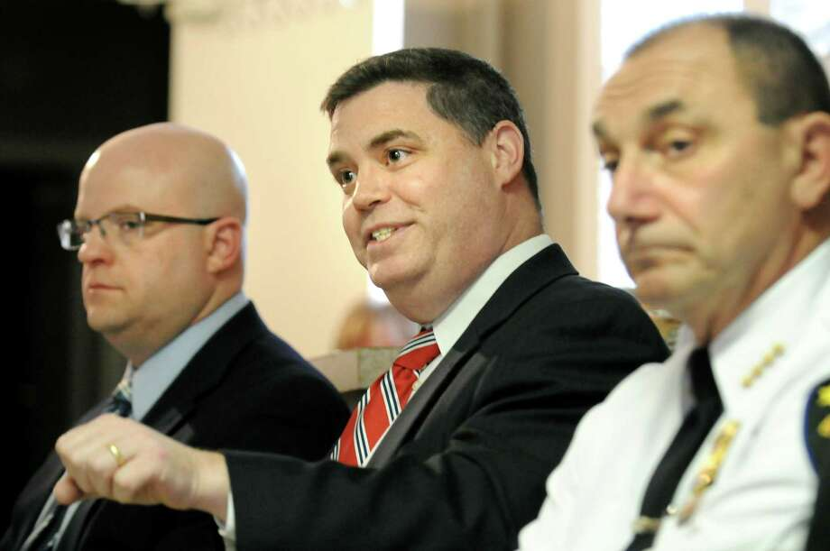 Federal prosecutor Dan Hanlon, center, talks with parolees about what will happen if they re-offend during a call-in for gun offenders on Thursday, April 16, 2015, at Bethel Baptist Church in Troy, N.Y. Joining him are Joel Abelove, Rensselaer County district attorney, left, and Troy Police Chief John Tedesco. (Cindy Schultz / Times Union) Photo: Cindy Schultz / 00031478A