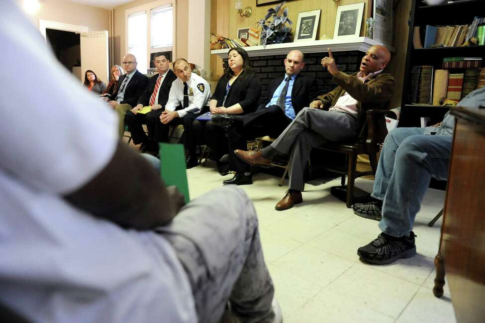 Andre Morris, cofounder of the ROOTS Program, right, talks with parolees about improving their lives during a call-in for gun offenders on Thursday, April 16, 2015, at Bethel Baptist Church in Troy, N.Y. Also on the panel are, from left, Joel Abelove, Rensselaer County district attorney; Dan Hanlon, federal prosecutor; Troy Police Chief John Tedesco; Wendy Brown, Rensselaer County parole re-entry coordinator; and Wesley Beato, Albany County director for the Center for Employment Opportunities. (Cindy Schultz / Times Union)