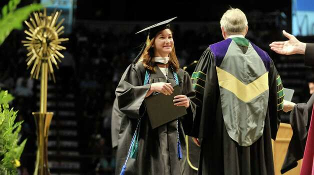 Graduate Catherine Gerrain walks across the stage after receiving her diploma during Siena College commencement at the Times Union Center on Sunday, May 10, 2015, in Albany, N.Y.  (Paul Buckowski / Times Union) Photo: PAUL BUCKOWSKI / 00031513A