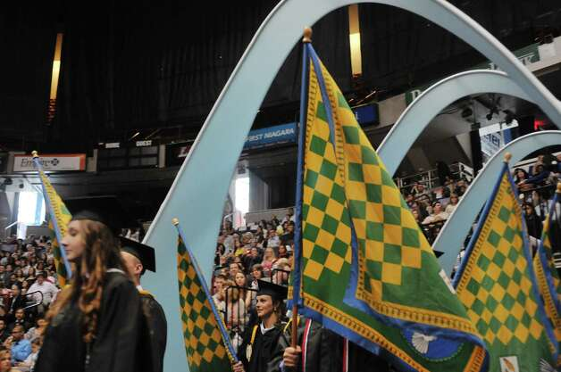 Graduates in the Alpha Kappa Alpha Honor Society process in during Siena College commencement at the Times Union Center on Sunday, May 10, 2015, in Albany, N.Y.  (Paul Buckowski / Times Union) Photo: PAUL BUCKOWSKI / 00031513A