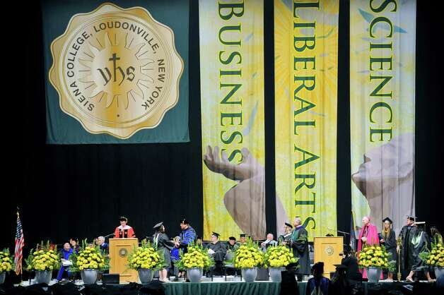 Graduates make their way across the stage as they receive diplomas during Siena College commencement at the Times Union Center on Sunday, May 10, 2015, in Albany, N.Y.  (Paul Buckowski / Times Union) Photo: PAUL BUCKOWSKI / 00031513A