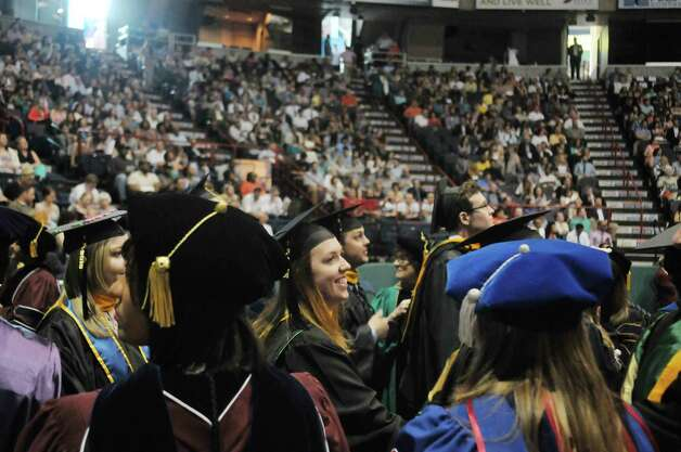 Graduates walk past their professors as they process in  during Siena College commencement at the Times Union Center on Sunday, May 10, 2015, in Albany, N.Y.  (Paul Buckowski / Times Union) Photo: PAUL BUCKOWSKI / 00031513A