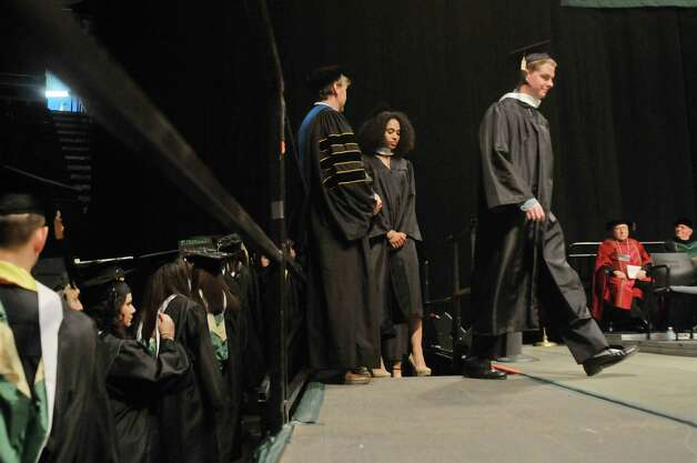 Graduates make their way up and onto the stage to receive their diploma during Siena College commencement at the Times Union Center on Sunday, May 10, 2015, in Albany, N.Y.  (Paul Buckowski / Times Union) Photo: PAUL BUCKOWSKI / 00031513A