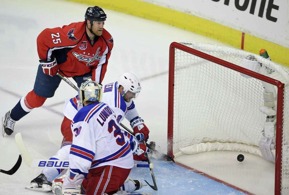 Washington Capitals left wing Jason Chimera (25) scores a goal against New York Rangers goalie Henrik Lundqvist (30), from Sweden, and Kevin Klein (8) during the second period of Game 6 in the second round of the NHL Stanley Cup hockey playoffs, Sunday, May 10, 2015, in Washington. (AP Photo/Nick Wass) ORG XMIT: VZN209