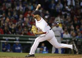 Boston Red Sox relief pitcher Edward Mujica delivers a pitch in the fourth inning of a baseball game against the Toronto Blue Jays, Tuesday, April 28, 2015, in Boston. (AP Photo/Steven Senne)