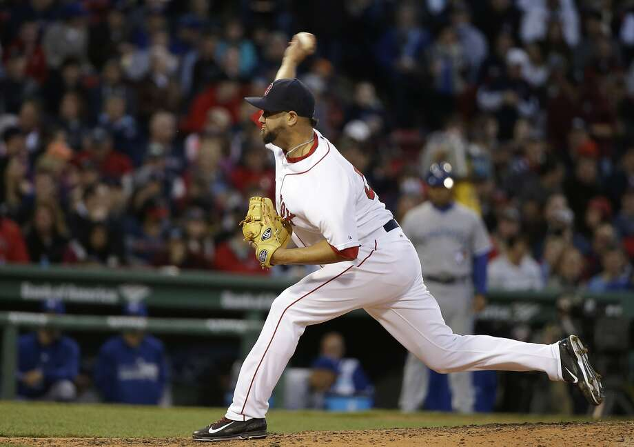 Boston Red Sox relief pitcher Edward Mujica delivers a pitch in the fourth inning of a baseball game against the Toronto Blue Jays, Tuesday, April 28, 2015, in Boston. (AP Photo/Steven Senne) Photo: Steven Senne, Associated Press