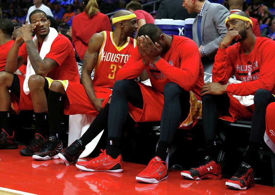 Instead of being involved in the fourth quarter, Rockets regulars, from left, Trevor Ariza, Jason Terry, Terrence Jones and Corey Brewer contemplated their fate. Photo: James Nielsen, Staff / © 2015  Houston Chronicle
