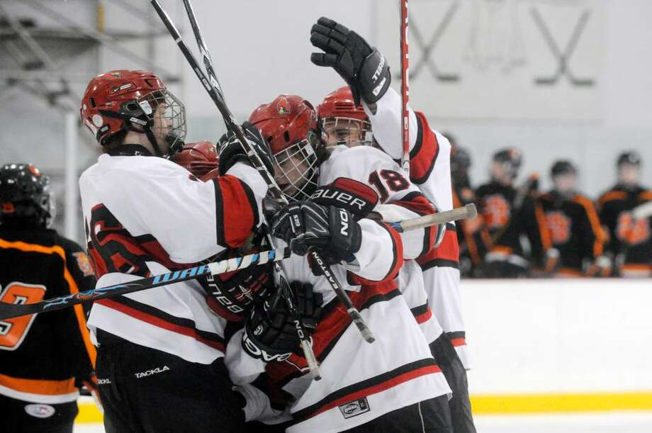 The Cardinals react to Jonathan Darula's first period goal as Greenwich High School hosts Ridgefield High in a boys hockey during the first round of the the Division I Boys Hockey Playoffs. Photo: Keelin Daly / Greenwich Time
