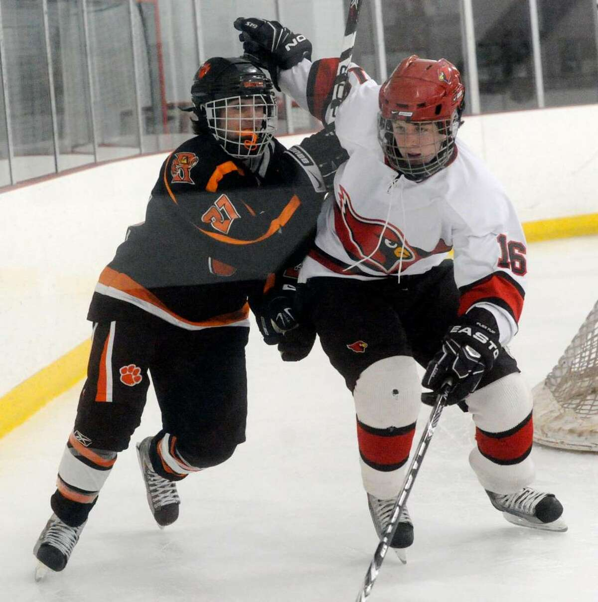 Greenwich's Jack Gilson and Ridgefield's Matthew Hrvatin battle as Greenwich High School hosts Ridgefield High in a boys hockey game during the first round of the Division I Boys Hockey Playoffs.